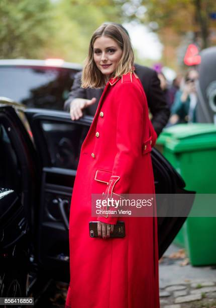 Olivia Palermo wearing a red coat seen outside Valentino during Paris Fashion Week Spring/Summer 2018 on October 1 2017 in Paris France