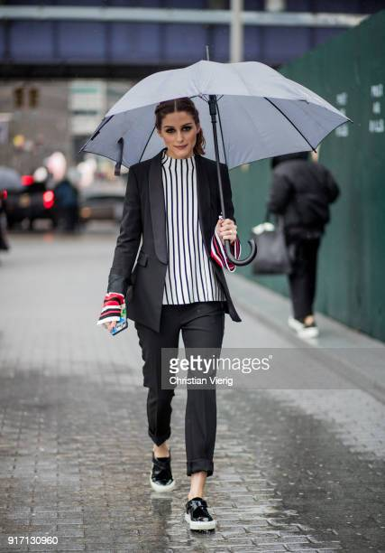Olivia Palermo wearing black blazer black pants striped top seen outside Tibi on February 11 2018 in New York City