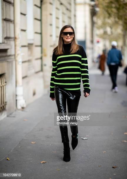 Olivia Palermo wearing green black striped knit black vinyl pants boots seen outside Alessandra Rich during Paris Fashion Week Womenswear...