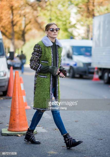 Olivia Palermo wearing green coat seen outside Moncler Gamme Rouge during Paris Fashion Week Spring/Summer 2018 on October 3 2017 in Paris France