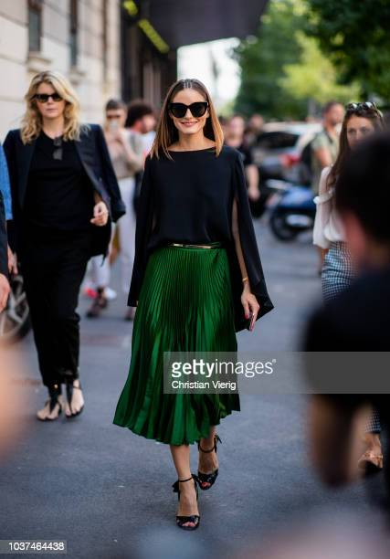 Olivia Palermo wearing green skirt, black cape, heeled sandals seen outside Etro during Milan Fashion Week Spring/Summer 2019 on September 21, 2018...