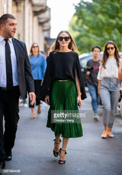 Olivia Palermo wearing green skirt black cape heeled sandals seen outside Etro during Milan Fashion Week Spring/Summer 2019 on September 21 2018 in...