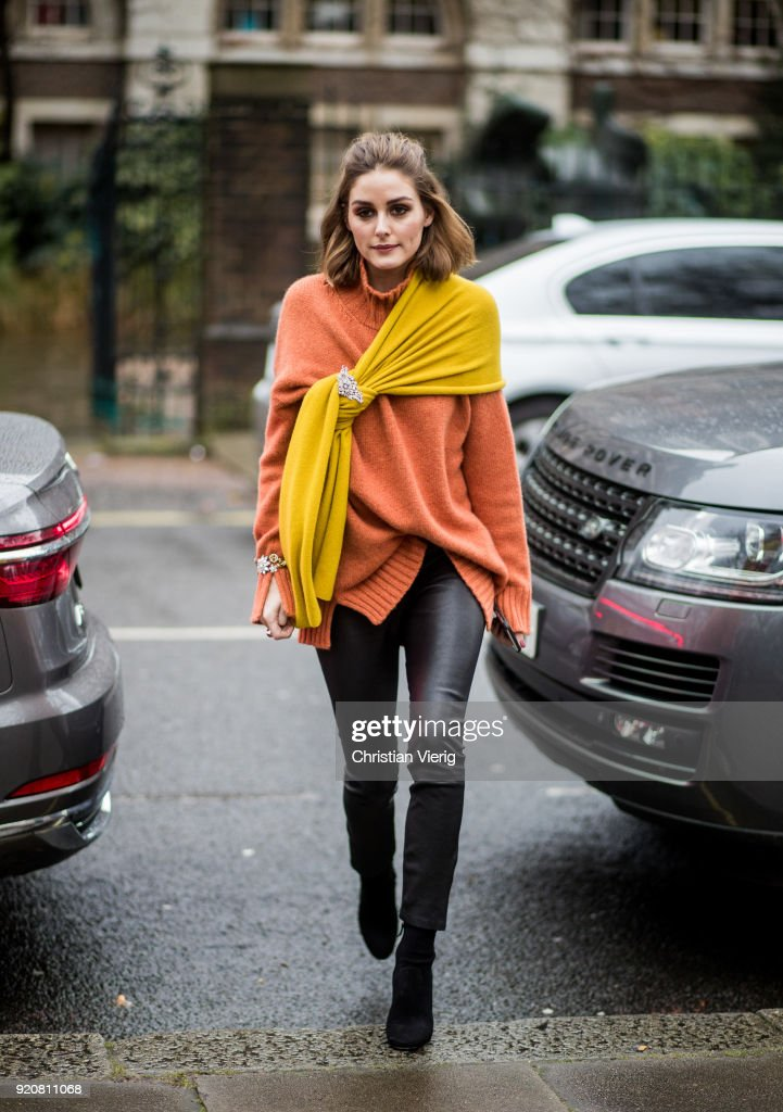 Olivia Palermo wearing orange turtleneck, black leather pants seen outside Christopher Kane during London Fashion Week February 2018 on February 19, 2018 in London, England.