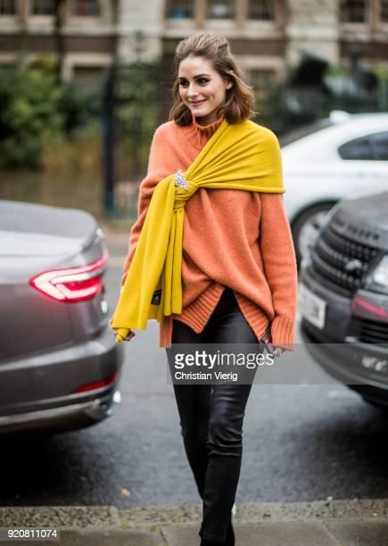 Olivia Palermo wearing orange turtleneck black leather pants seen outside Christopher Kane during London Fashion Week February 2018 on February 19...