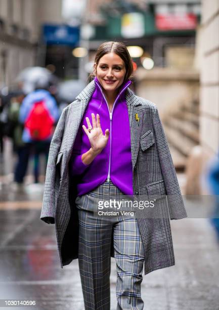 Olivia Palermo wearing purple zipped jacket grey plaid wool coat and pants ankle boots is seen outside Tibi during New York Fashion Week...
