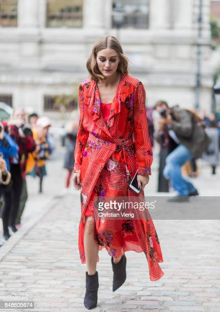 Olivia Palermo wearing red dress outside Preen during London Fashion Week September 2017 on September 17 2017 in London England