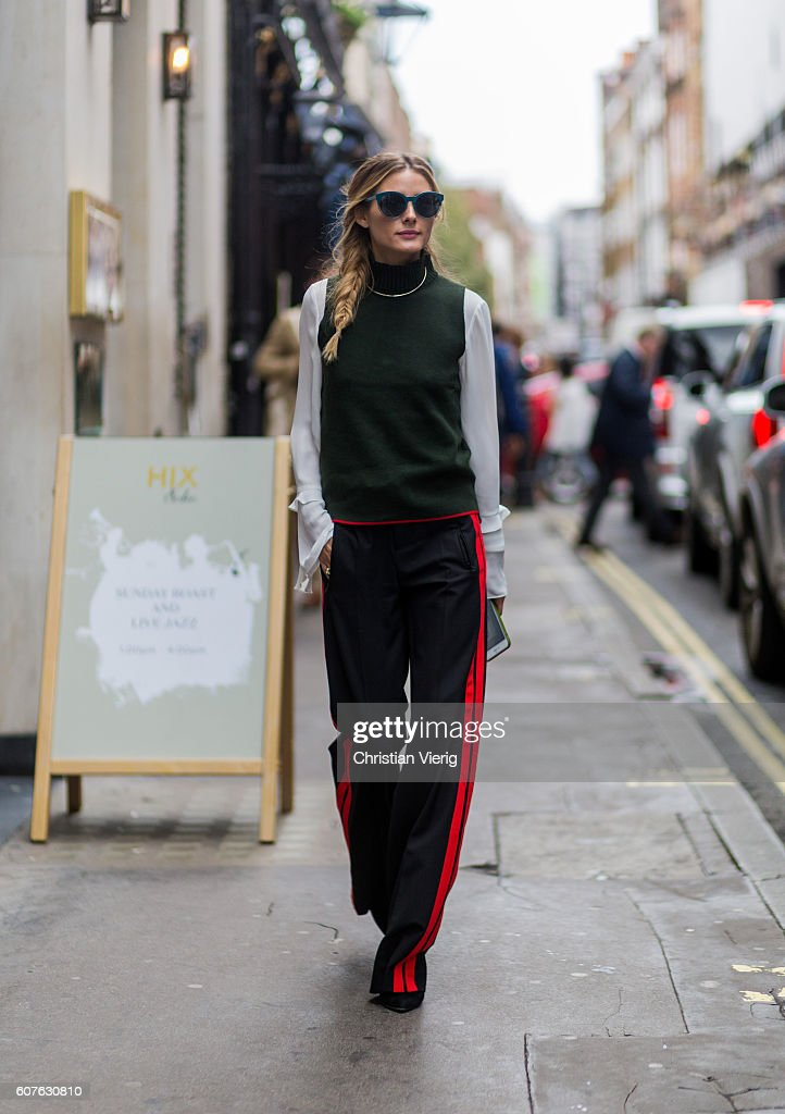 Olivia Palermo wearing sunglasses, a green sleeveless jumper, white blouse, black track suit pants outside Mary Katrantzou during London Fashion Week Spring/Summer collections 2017 on September 18, 2016 in London, United Kingdom.