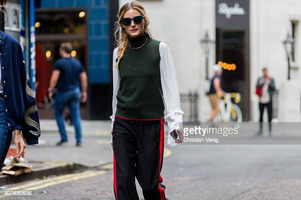 Olivia Palermo wearing sunglasses a green sleeveless jumper white blouse black track suit pants outside Mary Katrantzou during London Fashion Week...