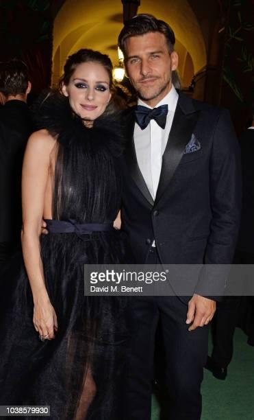 Olivia Palermo, wearing Tods X Isko, and Johannes Huebl, wearing Tods X Isko, attend The Green Carpet Fashion Awards Italia 2018 at Teatro Alla Scala...