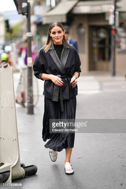 Olivia Palermo wears a black jacket, a black pleated skirt, white shoes, outside Ralph & Russo, during Paris Fashion Week - Womenswear Spring Summer...