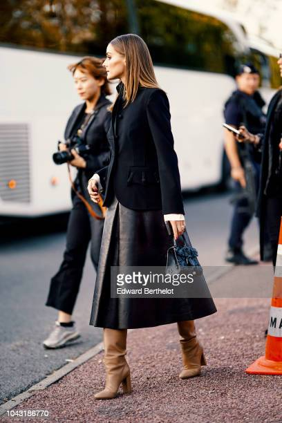Olivia Palermo wears a black jacket and a black dress outside Hermes during Paris Fashion Week Womenswear Spring/Summer 2019 on September 29 2018 in...