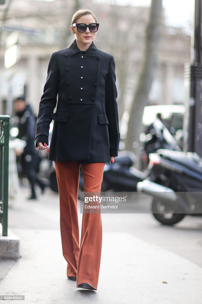 Olivia Palermo wears a black military jacket, and orange pants, outside the Miu Miu show, during Paris Fashion Week Womenswear Fall/Winter 2017/2018, on March 7, 2017 in Paris, France.