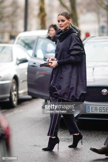 Olivia Palermo wears a black Valentino VLTN long bomber coat with a hoodie outside Valentino during Paris Fashion Week Womenswear Fall/Winter...