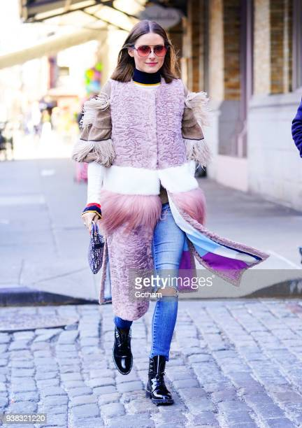 Olivia Palermo wears a chic pink furry outfit when out and about with brother Douglas Palermo on March 26 2018 in New York City