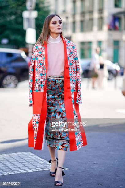 Olivia Palermo wears a flower print kimono jacket a pink top a skirt outside Fendi during Paris Fashion Week Haute Couture Fall Winter 2018/2019 on...