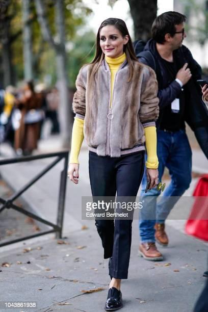 Olivia Palermo wears a fur coat a yellow turtleneck outside John Galliano show during Paris Fashion Week Womenswear Spring/Summer 2019 on September...