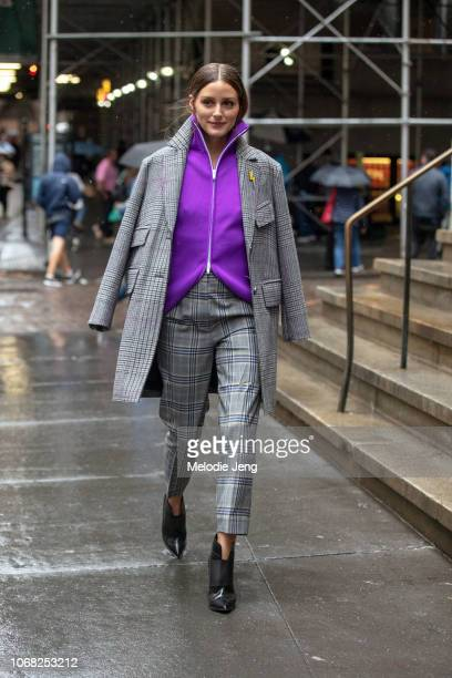 Olivia Palermo wears a gray print jacket and pants and purple top at the Tibi show during New York Fashion Week Spring/Summer 2019 on September 9...