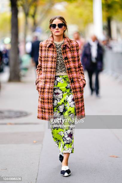Olivia Palermo wears a pink checked coat a green floral print skirt sunglasses outside Miu Miu during Paris Fashion Week Womenswear Spring/Summer...