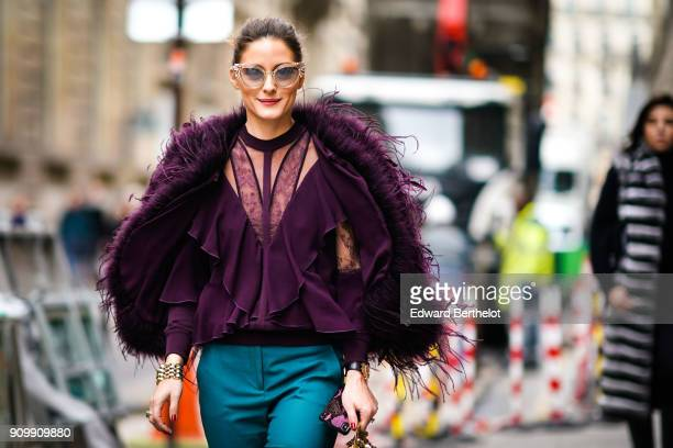 Olivia Palermo wears a purple fur coat blue pants sunglasses outside Elie Saab during Paris Fashion Week Haute Couture Spring/Summer 2018 on January...