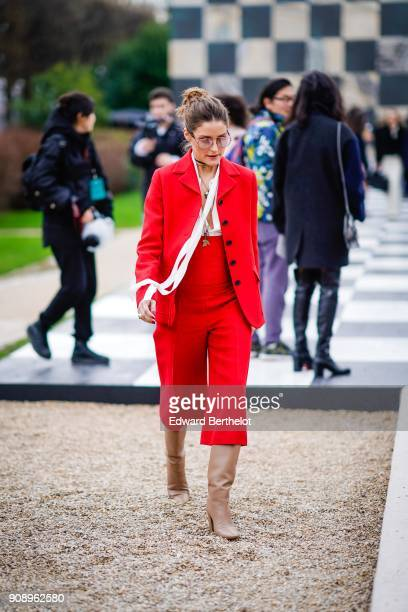 Olivia Palermo wears a red outfit after Dior during Haute Couture Spring/Summer 2018 on January 22 2018 in Paris France