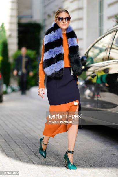 Olivia Palermo wears a striped scarf and an orange dress outside Miu Miu during Paris Fashion Week Womenswear Spring/Summer 2018 on October 3 2017 in...
