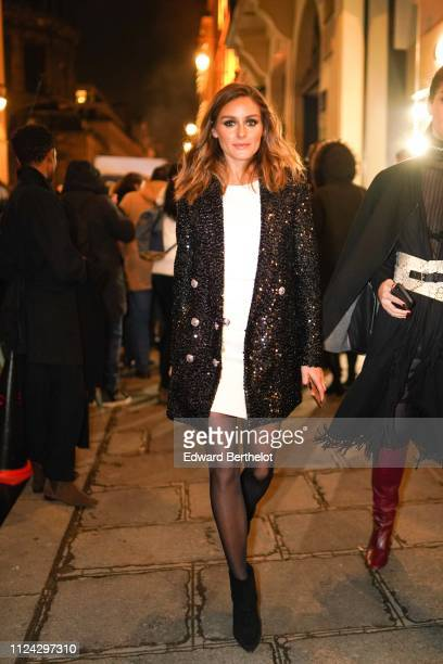 Olivia Palermo wears a white dress a glitter shiny blazer jacket outside Balmain during Paris Fashion Week Haute Couture Spring Summer 2020 on...