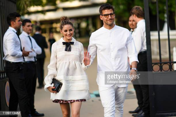 Olivia Palermo wears a white dress and a black sequined bow tie ; Johannes Huebl wears a white shirt, glasses, outside Miu Miu Club 2020, on June 29,...