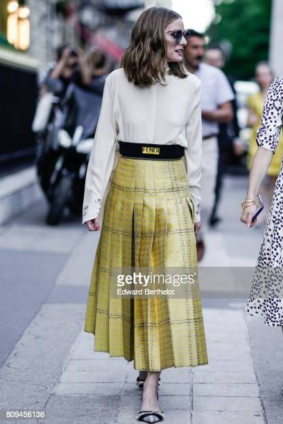 Olivia Palermo wears sunglasses a white shirt a Fendi gold dress heels outside the Fendi show during Paris Fashion Week Haute Couture Fall/Winter...