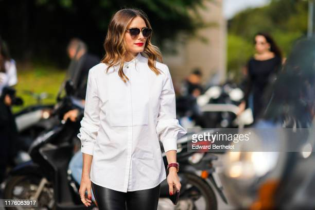 Olivia Palermo wears sunglasses, a white shirt, black leather pants, outside the Tod's show during Milan Fashion Week Spring/Summer 2020 on September...
