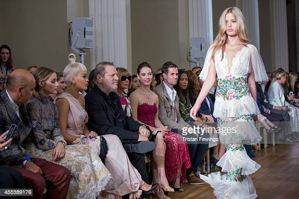 Olivia Palmero Rita Ora Harvey Weistein and Anna Wintour watch Georgia Mae Jagger walk the runway during the Marchesashow during London Fashion Week...