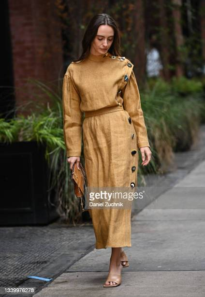 Olivia Perez is seen wearing a tan dress with brown bag outside the Tory Burch show during New York Fashion Week S/S 22 on September 12, 2021 in New...