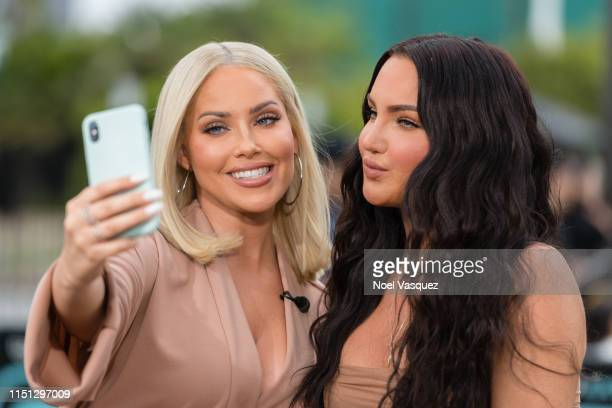 """Olivia Pierson and Natalie Halcro visit """"Extra"""" at Universal Studios Hollywood on May 23, 2019 in Universal City, California."""