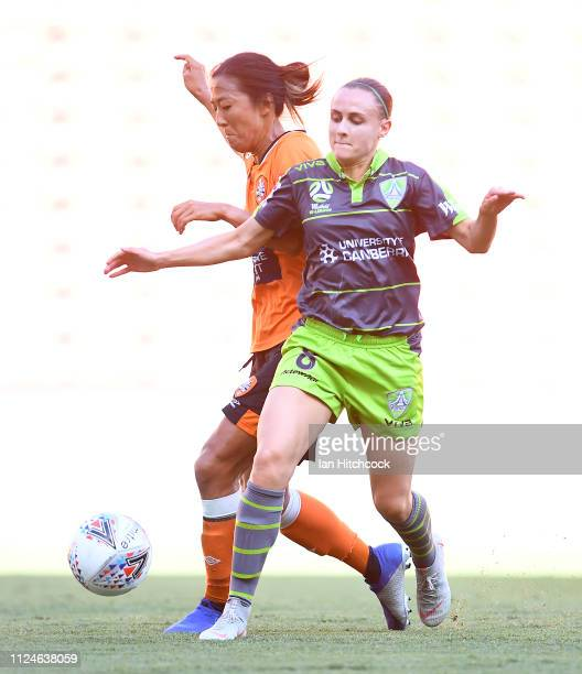 Olivia Price of Canberra United contests the ball with Yuki Nagasato of the Roar during the round 13 WLeague match between the Brisbane Roar and...