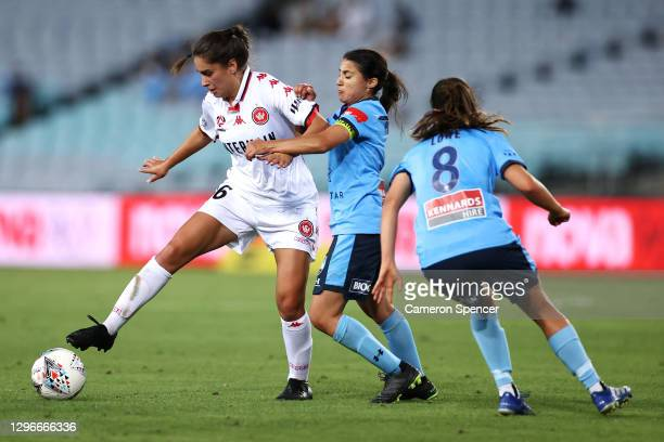 Olivia Price of the Wanderers is tackled during the round four W-League match between Sydney FC and the Western Sydney Wanderers at ANZ Stadium, on...