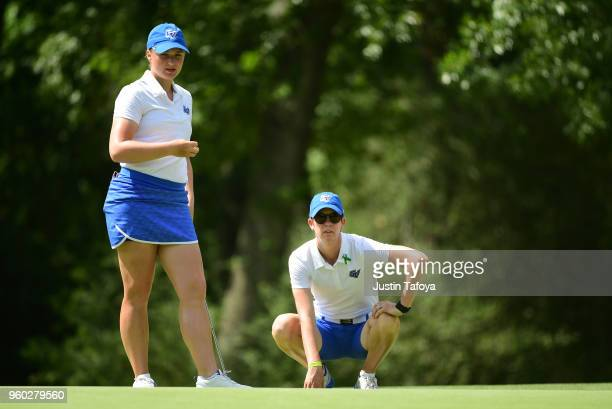 Olivia Reed of Grand Valley State looks at a putt with her coach Rebecca Mailloux during the Division II Women's Golf Championship held at Bay Oaks...