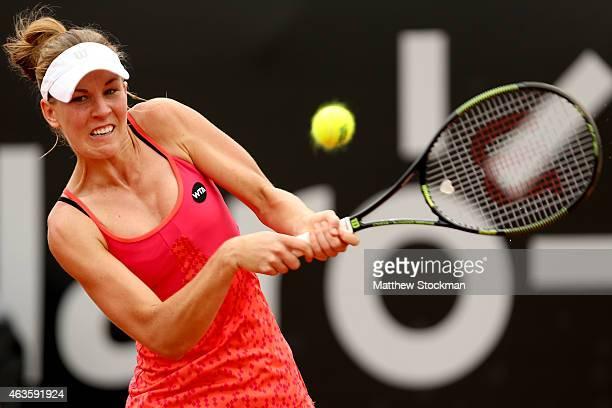 Olivia Rogowska of Australia returns a shot to Irina-Camelia Begu of Romania during the Rio Open at the Jockey Club Brasileiro on February 16, 2015...