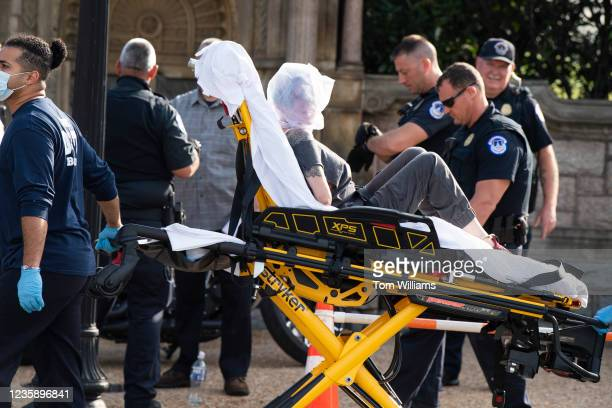 Olivia Romano is taken to an ambulance after being arrested for attacking U.S. Capitol Police while wielding a baseball bat on 1st Street near the...