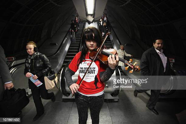 Olivia Shotton plays Mozart's Zweites Konzert on the violin in Waterloo's underground station on January 4 2011 in London England Musicians at Canary...