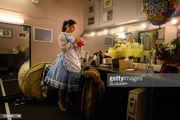 Olivia Sloyan, playing Belle in the Christmas pantomime 'Beauty and the Beast', prepares to wear her face mask before leaving her dressing room prior...