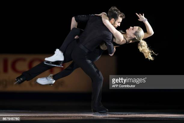Olivia Smart and Adria Diaz of Spain skate their exhibition program on at the ISU Grand Prix of Figure Skating's Skate Canada International at Brandt...