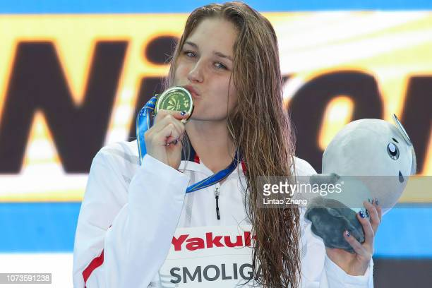 Olivia Smoliga of the United States poses with her medal during medal ceremony for the Women's 50m Backstroke on day 5 of the 14th FINA World...