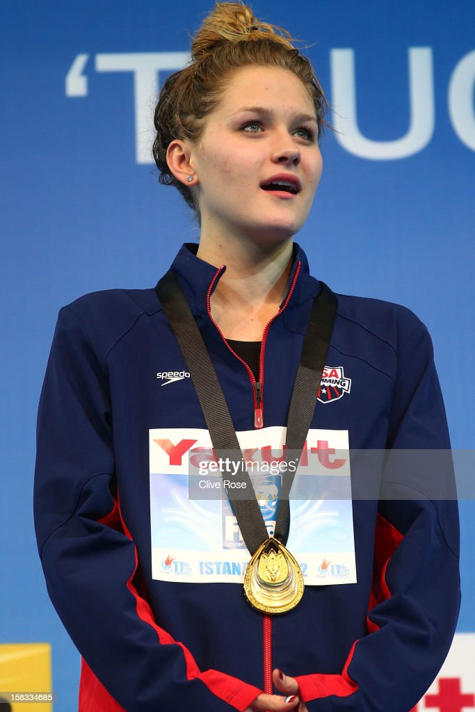 Olivia Smoliga of USA poses with her Gold medal on the podium after winning the Women's 100m Backstroke Final during day two of the 11th FINA Short Course World Championships at the Sinan Erdem Dome on December 13, 2012 in Istanbul, Turkey.