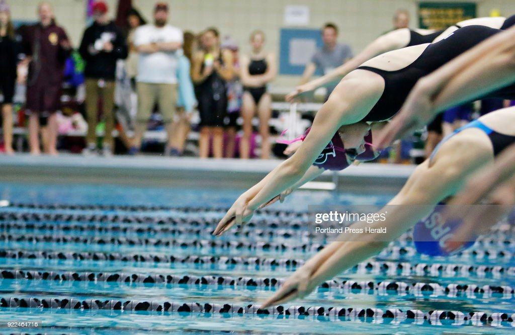 Olivia Tighe of Cape Elizabeth dives in for the 100 yard freestyle at the Maine HIgh School Girls Class B State Swimming and Diving Championships at Bowdoin College.