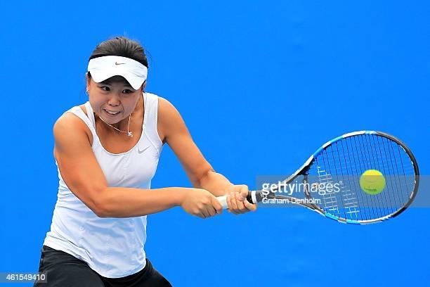 Olivia Tjandramulia of Australia plays a backhand in her qualifying match against Viktorija Golubic of Switzerland for the 2015 Australian Open at...