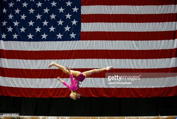Olivia Trautman competes on the beam in the junior women preliminaries during the 2014 PG Gymnastics Championships at Consol Energy Center on August...