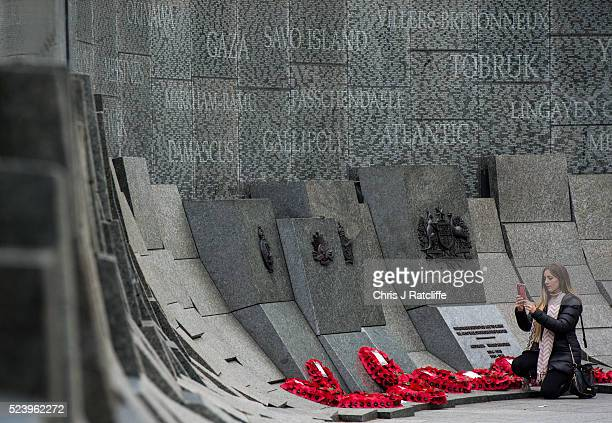 Olivia Watson from Adelaide Australia takes photos of tributes left at the Australian war memorial during Anzac Day at Hyde Park on April 25 2016 in...