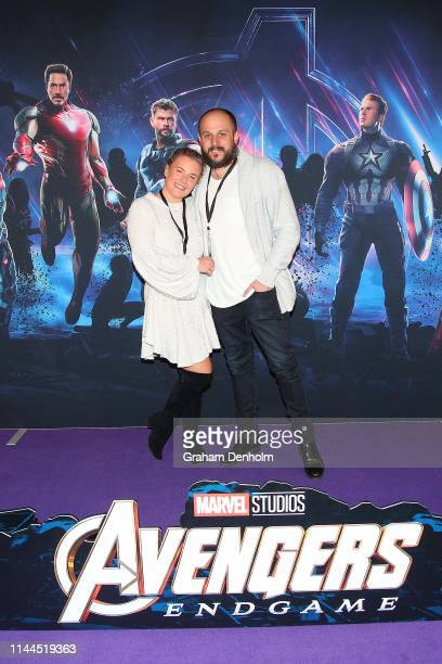 Olivia White and her husband pose ahead of the special screening of Marvel Studios' Avengers Endgame at IMAX Melbourne Museum on April 23 2019 in...