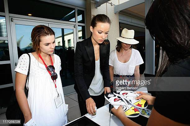 Olivia Wilde and guests check out Havaianas at the WIRED Cafe at ComicCon on July 23 2009 in San Diego California