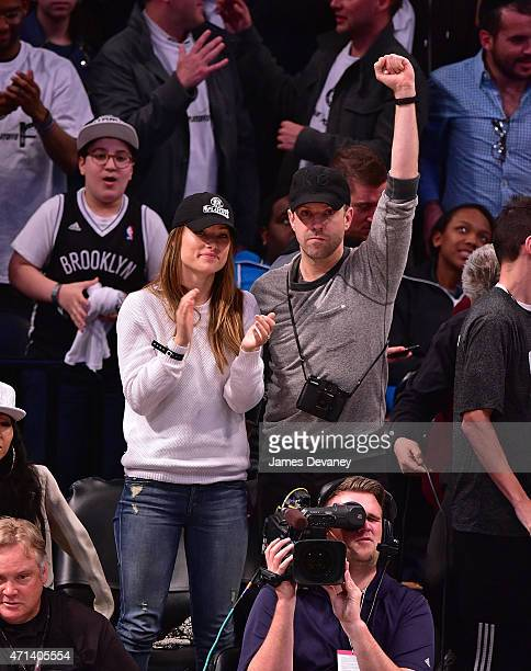 Olivia Wilde and Jason Sudeikis attend the Atlanta Hawks vs Brooklyn Nets game at Barclays Center on April 27 2015 in New York City