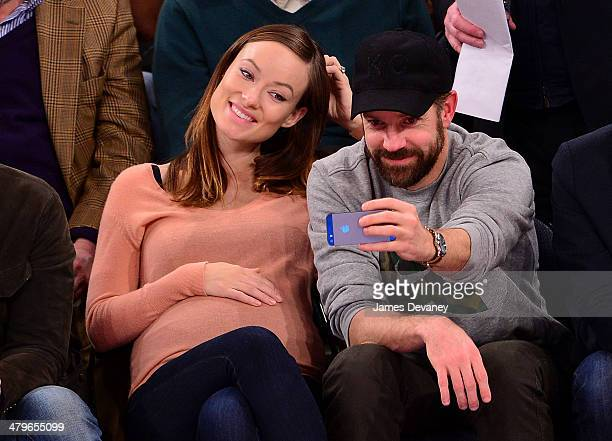 Olivia Wilde and Jason Sudeikis attend the Indiana Pacers vs New York Knicks game at Madison Square Garden on March 19 2014 in New York City